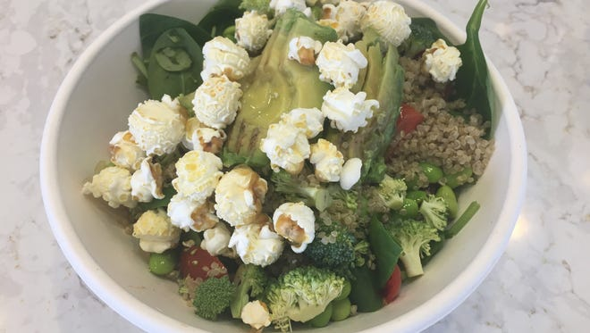The Power House salad topped with popcorn from Shreveport's Sugarwalk Popcorn.