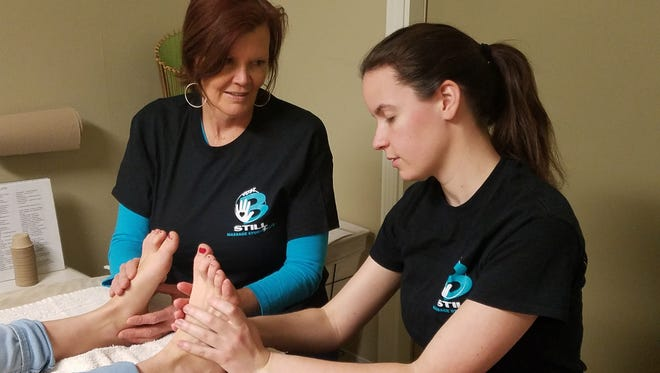 Samantha Klein, at right, is shadowing Just B-Still's Ann Sinisi while attending Blue Sky School of Massage.