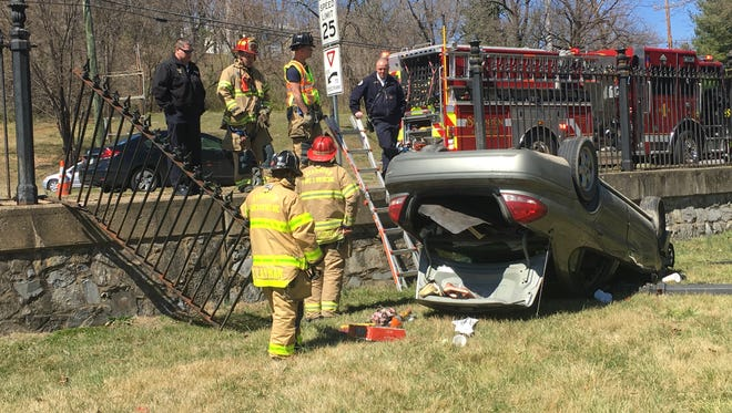 Police said a woman drove through a fence and flipped her car Wednesday afternoon on Greenville Avenue in Staunton.
