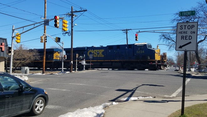 The rail crossing at West Clinton Avenue and South Front Street where a New York woman's car got stuck before it was hit by a freight train on March 22.