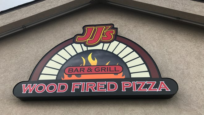 The new sign at JJ's Bar & Grill at 4015 S. Taft Hill Road. The restaurant specializes in wood-fired pizzas.