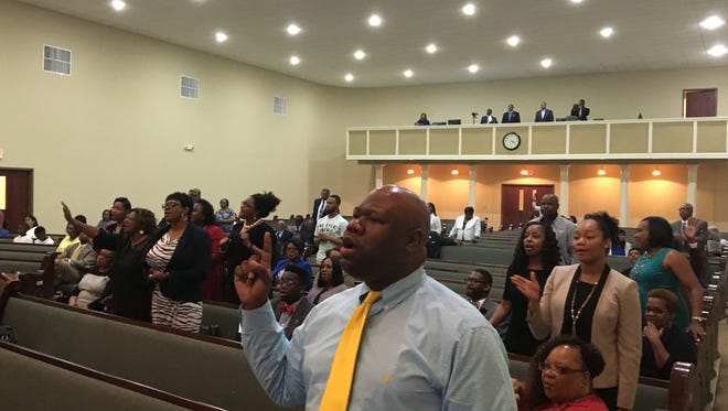 Harvey Williams Jr. and others in attendance sing in a fundraising worship service held for Jackson State University Sunday at St. Luther Missionary Baptist Church.