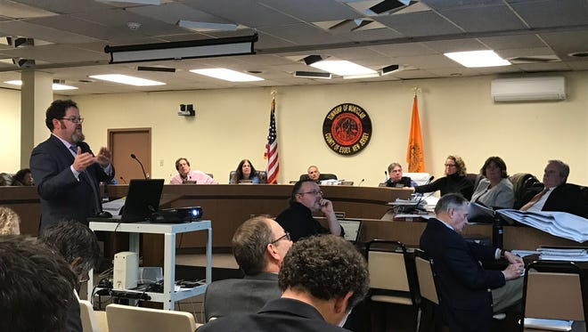 Architect Bruce Stieve presents designs for the buildings in the Wellmont/Seymour Street redevelopment area during the Montclair Planning Board meeting on Monday night, March 27.