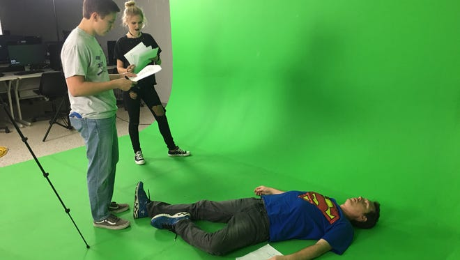 Students on the set of their film production. The aspiring filmmakers will submit their original short movies into the Louisiana Film Prize Junior festival/competition.
