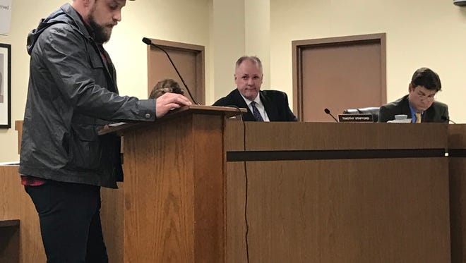 Jason Gleason, manager of the Pig and Prince restaurant in Montclair, speaks about an ordinance to require businesses to post prices, at the March 28 council meeting.