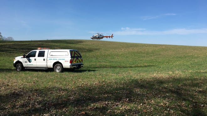 Lifestar helicopter and authorities respond to a paraglider in West Knox County on Sunday, April 2, 2017.