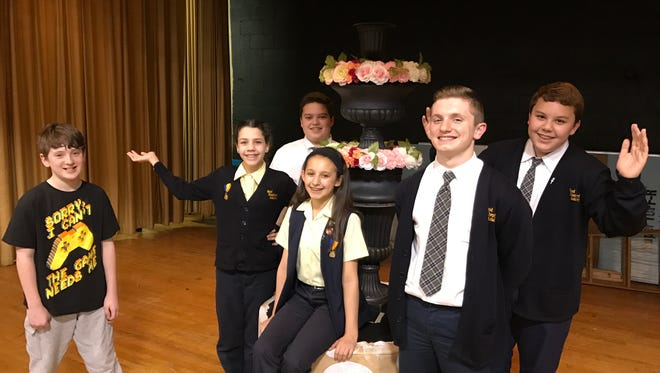 "From left, Lucas Lorent (Cogsworth), Brianne Santos (Mrs. Potts), Tryston Minnoia (Maurice), Carmela Alessio (Belle), Ryan Yuhas (Beast) and Robert McCafferty (Lumiere) rehearse ""Disney's Beauty and the Beast"" at Good Shepherd Academy in Nutley."