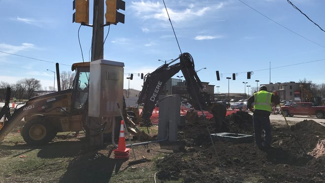 Crews work on the northwestern corner of the intersection of Louise Avenue and 49th Street. The intersection is scheduled to close Monday and stay closed until July.
