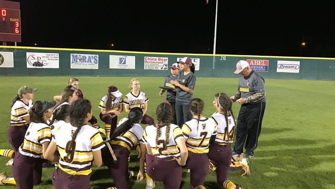 Tuloso-Midway coach Sally Deleon talks to her team after a 6-3 win against King on April 7, 2017 at the Tuloso-Midway High School softball field.