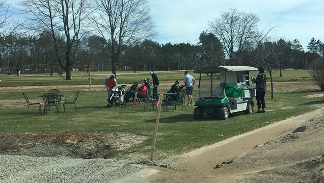 Players get ready to play at the Stevens Point Country Club, which is completing a major renovation of its course and grounds this year.