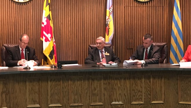 Bob Culver, Wicomico County Executive (left) and Salisbury Mayor Jake Day (right), sign a new fire service agreement on Friday, April 7, 2017, that would decrease how much money the city would be paid for providing fire and ambulance services outside city limits.