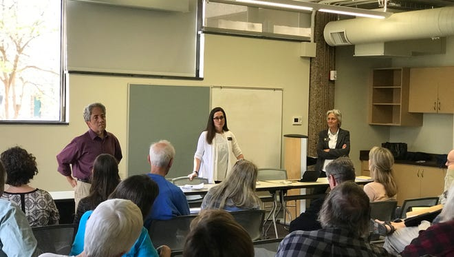 Rep. Jeni Arndt, center, answers an audience member's question at a town hall on April 8, 2017. She is joined by Sen. John Kefalas and Rep. Joann Ginal, all Fort Collins Democrats.