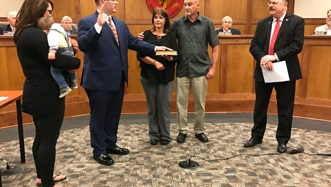 New Wanaque police officer Daniel J. Banker Jr. is sworn in by Mayor Daniel Mahler as his parents, Jeannie and Daniel look on along with  his girlfriend Laura Neuner and their 6-month-year-old son, Owen.