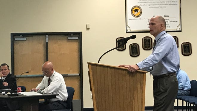 Terry St. Cyr, the Escambia County School District assistant superintendent of finance and business services, briefs the school board on budget projections for the upcoming school year at a board meeting on Friday, April 14, 2017 in Pensacola.