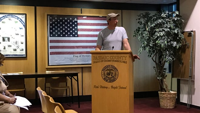 Christopher Takacs, president of Friends of Garret Mountain Reservation, speaks to the Passaic County freeholders during their meeting last Tuesday about why he is opposing to the construction of a disc golf course in Rifle Camp Park.