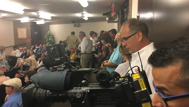 A standing room only crowd fills Fort Myers city chambers Monday evening, drawn by two top of mind, city-wide concerns -- the Freeh report on Fort Myers police dysfunction, and the midtown plan which will double the size of the downtown area if approved.