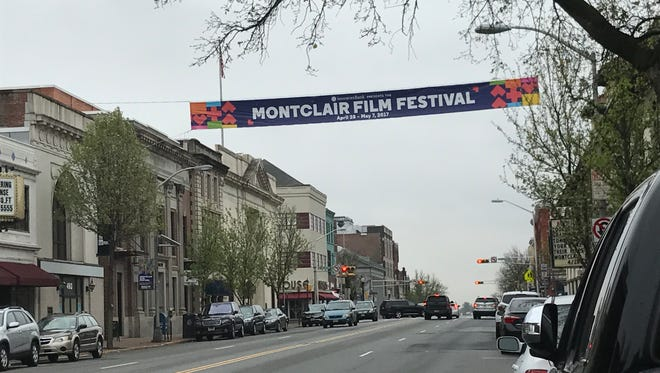 A banner in the middle of Bloomfield Avenue advertises the Montclair Film Festival.