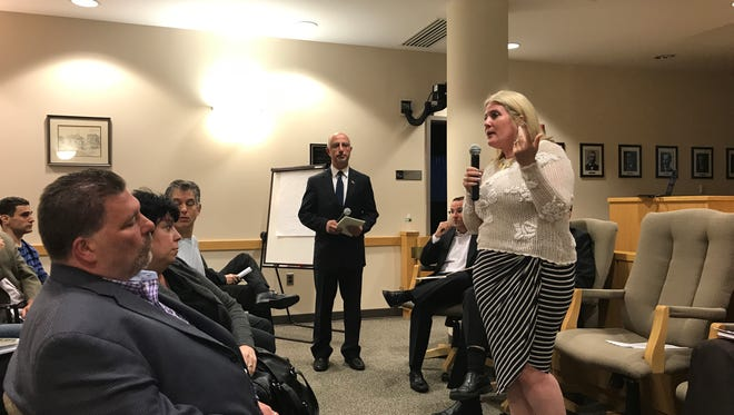 Assemblywoman Holly Schepisi speaks to Montvale residents about the realities of affordable housing.