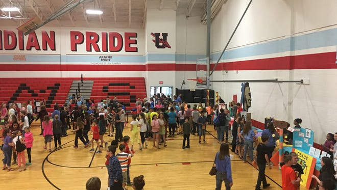 Fifth graders mingled in the gym learning more about their soon-to-be school.