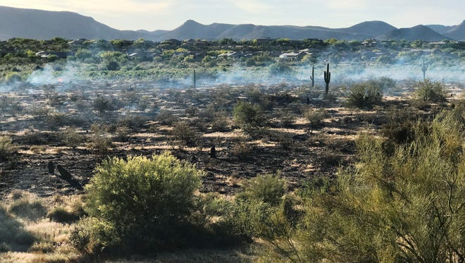 A brush fire was burning about 20 acres in the Anthem area on April 21, 2017.