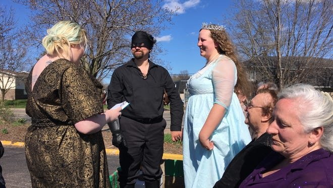 Craig Van Schyndel and Helen Fojut, of Stevens Point, are married before the start of the Trivia Parade on April 21, 2017. Both are members of the Trivia team TDSTR.