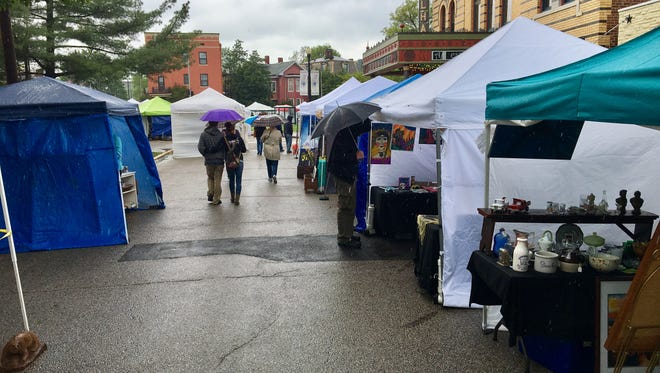 Vendors, visitors, gather despite the rain for eighth annual Funk in the City Art's Festival at Haynie's Corner.