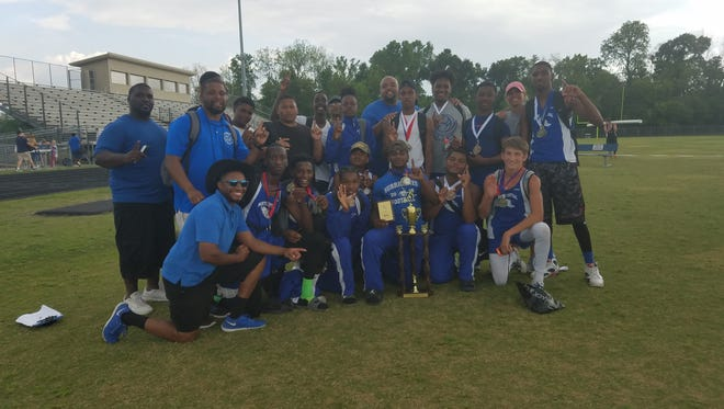 The North Central HIgh School track teams show off awards won at the District 5-1A track meet at Port Allen High Tuesday.
