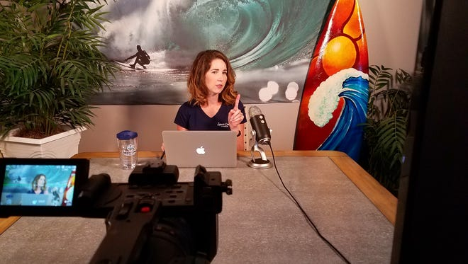 """Jeanna Wood, content manager for the Space Coast Office of Tourism, is the host for the """"Space Coast Live"""" shows on Facebook Live and YouTube Live during the countdowns to rocket launches."""