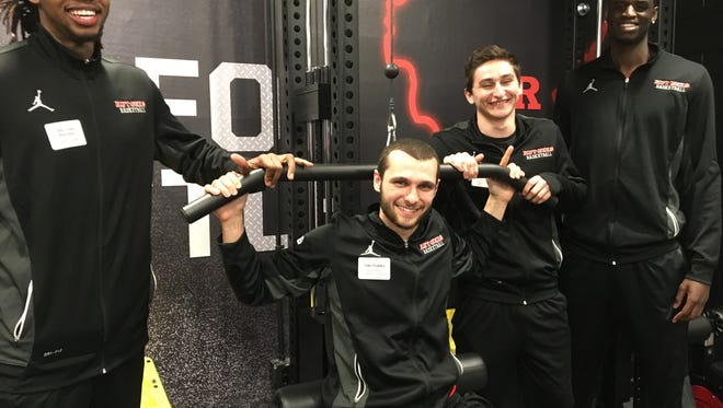 Members of the Rutgers men's basketball team test out their new weight room.