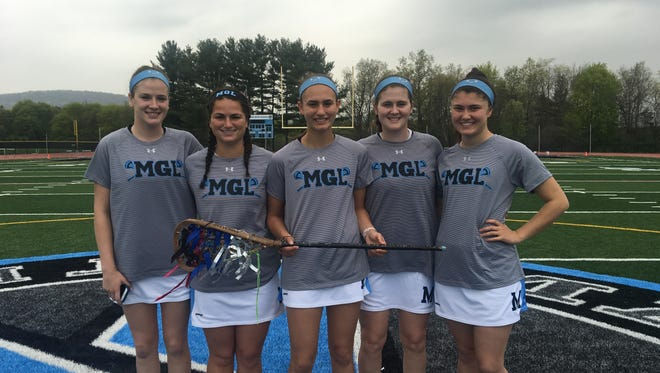 Mahwah girls lacrosse seniors with old stick: (from left) Erin Jaffe, Briana Blake, Meaghan Van Duren, Brenna Jaffe and Allie Tzanateas.