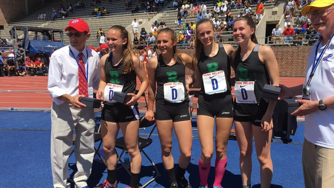 Ridge 4x800 members (left to right): Kaitlyn Van Baalen, Brooke Fazio, Catherine Giuseffi and Meghan Convery receive their Penn Relays watches.