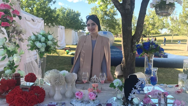 Sarah Hussein, 24, promotes her party business at the Arab American Festival on Saturday, April 29, 2017.