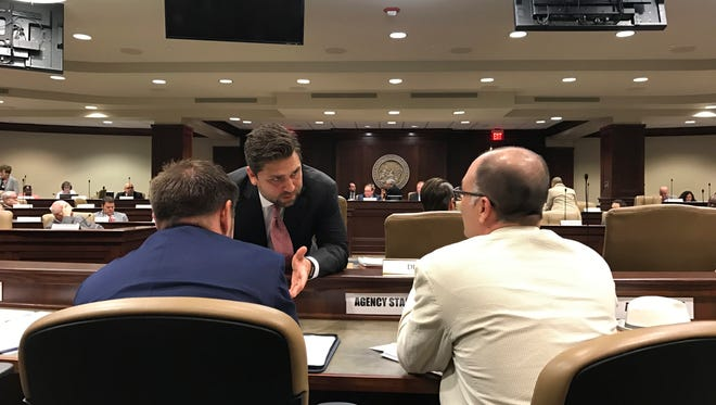 Senate President Jonathan Dismang speaks to officials from the state Department of Finance and Administration as the Joint Budget Committee meets on Tuesday, May 2, 2017, in Little Rock, Ark. Arkansas lawmakers gave initial approval Tuesday to legislation that would move 60,000 off the state's hybrid Medicaid expansion and impose a work requirement on some participants. A special session to take up the proposed changes is expected to end Wednesday.