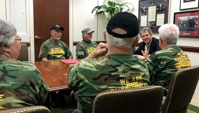 Sen. Sherrod Brown meets with retired coal miners in March as they lobby Congress to shore up their health and pension funds.