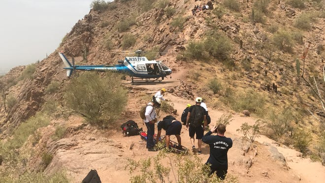 Technical rescue teams took a 27-year-old woman off Camelback Mountain with a helicopter. Firefighters carried the patient up to the helipad where the helicopter can land. She suffered from an isolated ankle injury and her friends attempted to carry her down but could go no further.