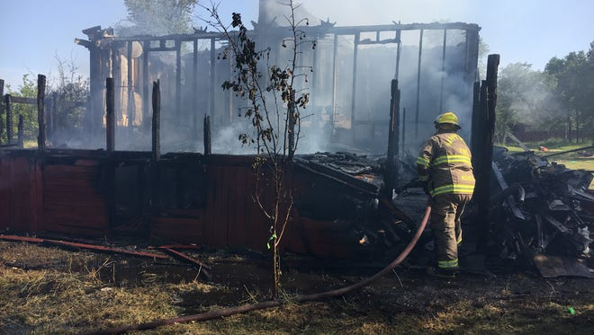 Cal Fire firefighters put out a fire that destroyed a mobile home on Serendipity Lane in Happy Valley on Wednesday.