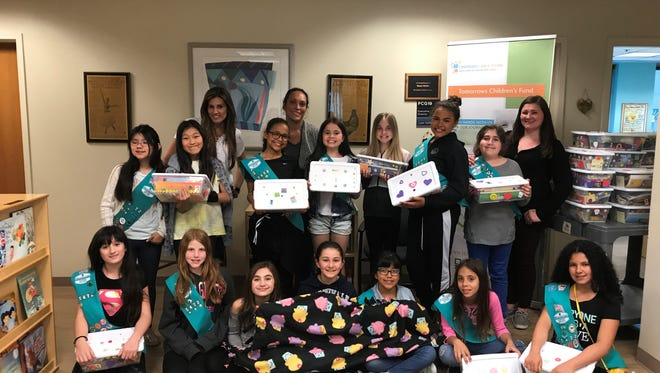 Northvale Girl Scout Troop 95742 meets at the Tomorrow Children' Fund to present their gift boxes on May 11, 2017.