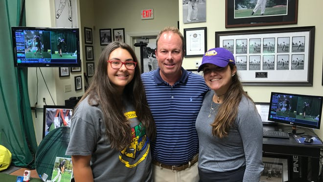 Swing coach Dave Cowger poses for a photo with two star pupils Sarah Johnson (left) and Presley Baggett (right) Friday at his Ridgeland studio.