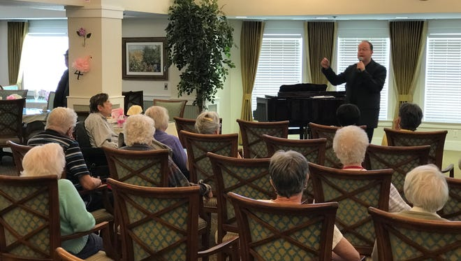 U.S. Rep. Jared Polis, a Democrat whose district includes Fort Collins, speaks at a town hall at Rigden Farm Senior Living on Monday, May 15.