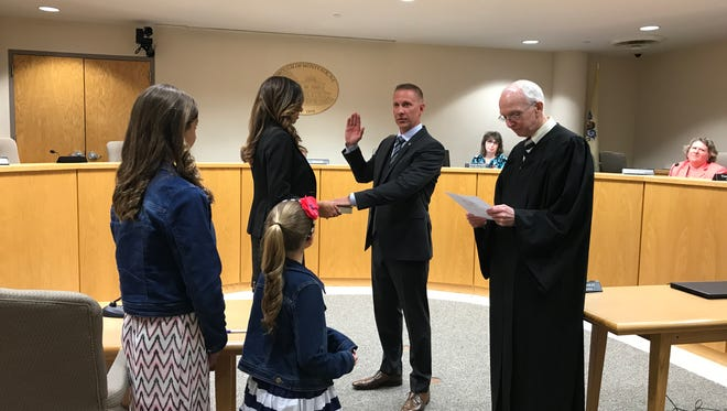 New Montvale Borough Councilman Doug Arendacs is sworn in by Judge Roy F. McGeady on May 9, 2017, as his family looks on