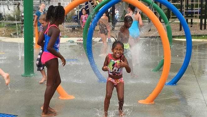 Child play at the splash pad at East End Park.
