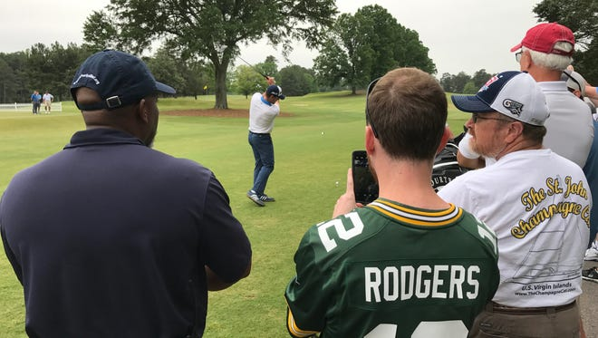 Green Bay Packers quarterback Aaron Rodgers tees off on the first hole of the BMW Charity Pro-Am at Furman University. Thursday, May 18, 2017
