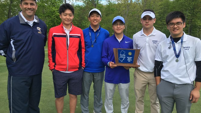 NV/Old Tappan golf team with state sectional trophy: (from left) coach Tom Quinn, J.J. Baek, Sam Yom, Chan Park, Ryan Travers and Ryan Lee.