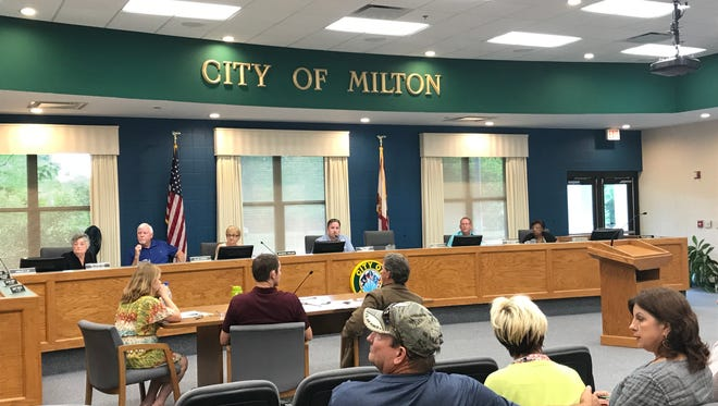 Members of the Milton City Council watch the tallies of a vote during a City Council Committee of the Whole meeting on Thursday, May 18, 2017, at City Hall in Milton.