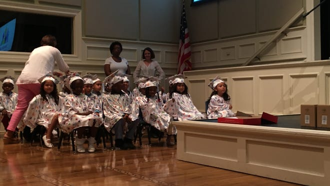 The 23 Class of 2017 graduates of HandsUp! Preschool wait to sing and get their diplomas at graduation on Friday, May 19 at First United Methodist Church.