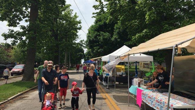 Families tour the sixth annual Streets Alive event in Garvin Park.