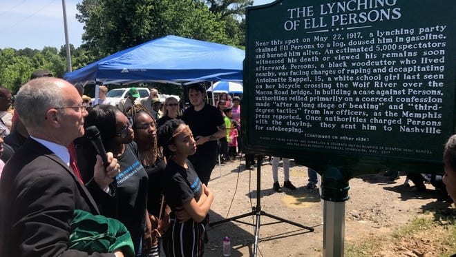 Shelby County Historian Jimmy Ogle reads the marker by Overton High School students commemorating the centennial of the Ell Persons lynching.