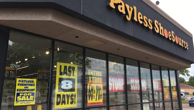 The closing Payless shoe store in front of the former K-Mart on East 10th Street is selling its products at deep discounts as it enters its final week.