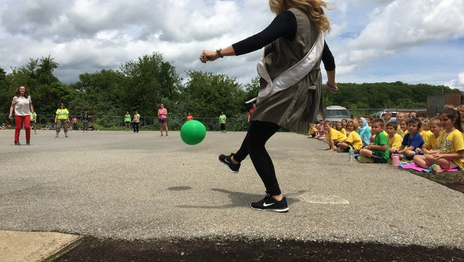 Miss Virginia 2016 Michaela Sigmon kicks a ball thrown by Virginia first lady Dorothy McAuliffe during an event celebrating Riverheads Elementary School winning the Virginia Breakfast Challenge.