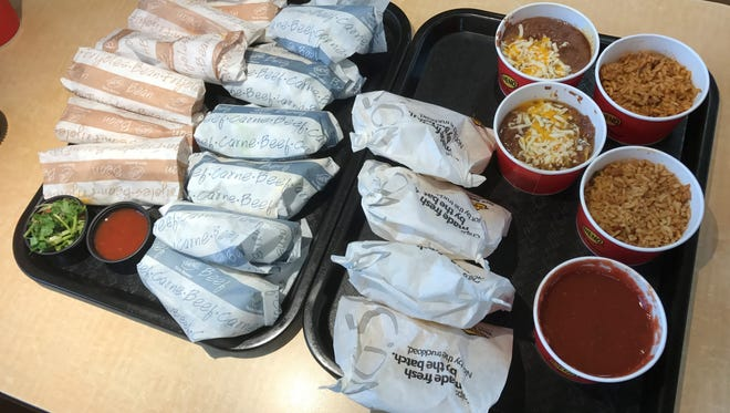 You get 12 tacos or burritos (or a mix) with Taco Bueno's gargantuan Wholottabox.